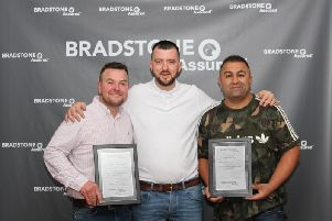 Jonathan Rogers (left) from Dynamic Landscaping and brothers Warren and Nathan Iqbal from Haydon Hill Paving with their awards