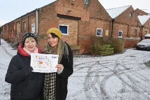 Linda Baxter and Sam Beeson, with their plans to turn a vast disused warehouse into a community 'hub'.
