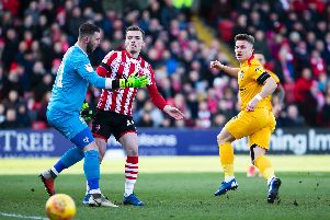 Sam Hoskins almost had this early chance to put Cobblers ahead at Sincil Bank. Pictures: Kirsty Edmonds