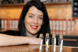 Headromance hair salon in Havant, has been hiding messages in bottles. 'Pictured is: Emily Warne, director.'Picture: Sarah Standing (080219-8796)