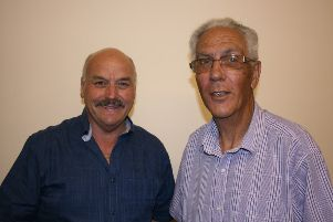 Martin Briggs (right) hands over the chairmanship to Mike Green