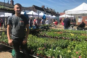 Luke Smith, of Smith and Marsh Plant and Produce of Boston enjoying a busy morning at Spilsby Market. ANL-190513-175015001