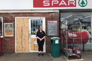 Deputy manager Louise outside the damaged Spar shop in Clapham