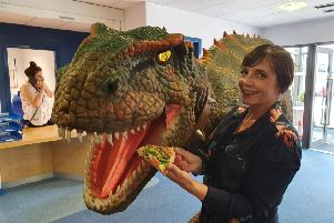 Dawn Dale from Wood Shed Pizza, hanging out with Pete the T-Rex