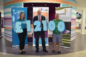 Brian Doran, SRC Chief Executive pictured with Louise Richardson, Cancer Focus NI and Damian Ruddy, The Kevin Bell Repatriation Trust