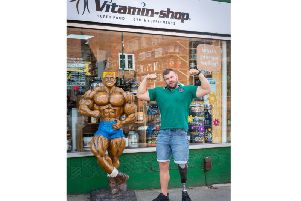Leamington shop owner Sebastian Glyda has secured his place in a UK body building championship just one year after he lost his left leg after he was crushed by an industrial cement mixer.
