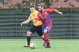 Northgate Olympic (red) v Kirton Reserves (yellow). Chris Hipkiss (red), Jack Reeson (yellow)