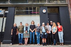 Teams from Heart of Hastings CLT and Project Artworks, standing outside 12 Claremont, Hastings, their latest project gifted to them as a community asset transfer from East Sussex County Council. Picture: Jonny Thompson