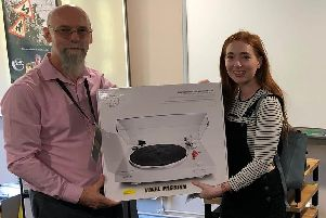 Michaela O'Sullivan receives her prize from Mark Sears