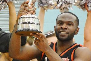 Storm captain Bode Adeluola with the National Cup trophy Hemel won last season.  (File picture by Lin Titmuss).