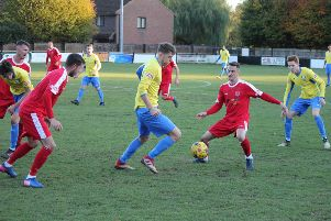 Berko's Matt Bateman keeps the ball away from Coleshill Town defenders. (File picture by Richard Solk)