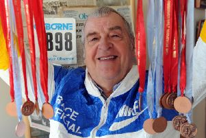 Graham Jessop with the old half marathon medals / Picture by Kate Shemilt