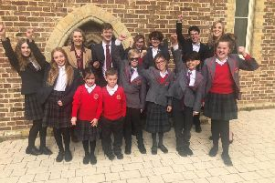 Chichester Free School children celebrate with interim principal, Jenny Clough (left) and newly appointed principal, Louise New, after the school retained its good Ofsted rating. Picture contributed