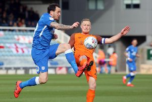 Posh player Lee Tomlin challenges Southend's Sam Mantom. Photo: Joe Dent/theposh.com.
