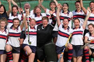 The BHHHC ladies' first team celebrate after clinching the Premier Division A title at the weekend.