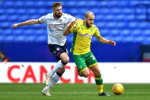 Mark Beevers (white) in action for Bolton against Norwich.