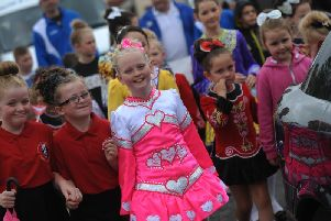 HOPE. Children from Creggan on parade in their Irish dancing costumes during the Creggan Festival.
