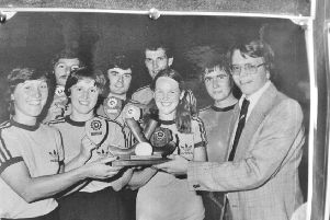 Bob French presents an indoor mixed hockey trophy to Bretton Beavers in the 1980s