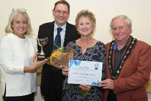 Best kept allotment award in memory of former mayor and allotment user Gordon Blythe. L-R Kathy Blythe presenting the trophy to Tim and Irene Bright, with deputy mayor Anthony Brand. EMN-191015-100740001