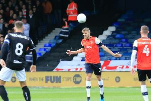 Town defender Martin Cranie clears the danger against Bristol City