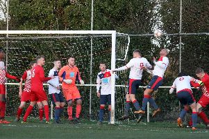 Goalmouth action during Rothwell Corinthians' 2-2 draw with ON Chenecks in the UCL Premier Division last weekend. Pictures by Alison Bagley