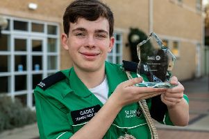 Oliver Faragher, 14, with his trophy as St John Ambulance's Regional Cadet of the Year. Picture: Brian Aldrich