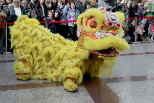 Chinese New Year celebration in Priory Meadow. Photo by Roberts Photographic SUS-190218-072742001