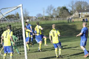 Battle Baptists captain Tom Saunders wins a header at a corner during the victory over St Teresa's Norris Green. Pictures by Simon Newstead