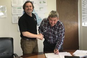 Keith Chapman (right) with East of England Arena manager Jason Lunn after signing the club's contract to race at the venue this season