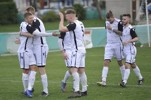 Bexhill United celebrate their opening goal in the 2-1 win at home to Oakwood