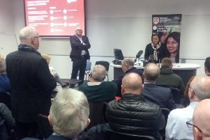 Rev Chris Hudson asks a question to Mary Lou McDonald, president of Sinn Fein, after she speaks at a civic unionist event at the Peter Froggatt at Queen's University, Belfast in February