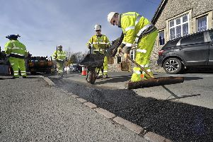 A highways crew fixing potholes in East Sussex