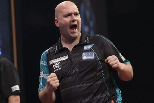 Rob Cross celebrates during his victory over Jeffrey De Zwaan in Rotterdam. Picture courtesy Lawrence Lustig/PDC