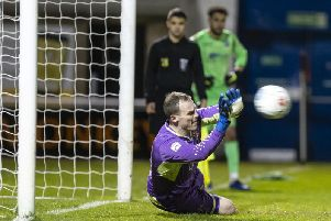 Brackley Town goalkeeper Danny Lewis saves Declan Rogers penalty to secure a 4-2 shoot-out success for his team as AFC Rushden & Diamonds were beaten in the NFA Hillier Senior Cup final. Pictures by Kirsty Edmonds