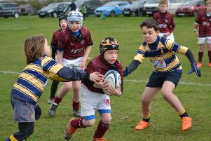 Ford battles through the defence in a great day for Melton RFC U9s EMN-190304-140724002