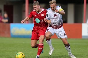 Action from Hastings United's 3-1 defeat away to Hythe Town in September's reverse fixture. Picture courtesy Scott White