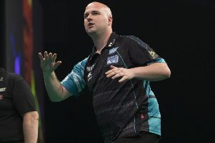 Rob Cross endured a disappointing night against Michael van Gerwen. Picture courtesy Lawrence Lustig/PDC
