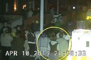 An image taken from the C.C.T.V. footage issued by the P.S.N.I. shows Lyra McKee in the crowd moments before a masked gunman opens fire.