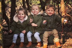 Triplets Penny, Polly and William Moyse turned three on Easter Sunday