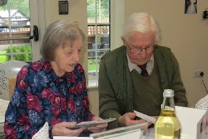 Keith and Hazel Wadkin look through their cards as they celebrate their diamond wedding EMN-190425-143105001