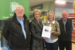 South Northamptonshire MP Andrea Leadsom accepts the petition calling for a bypass for Farthinghoe from campaigners
