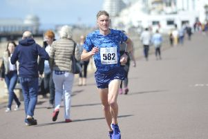 Adam Clarke on his way to a course record time in the 2019 Hastings Runners 5 Mile Race this morning. Picture by Simon Newstead