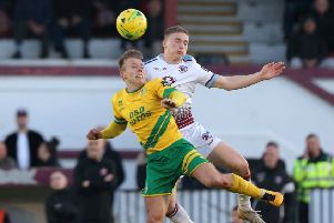 Adam Lovatt goes up for a header during Hastings United's play-off semi-final defeat by Ashford United. Picture courtesy Scott White