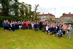 Fr Joe Gormley  and Fr Paul Fraser pictured with parishioners, pupils and teachers from Holy Child PS, St John's PS and St Cecilia's College at the present planting an Oak sapling to commemorate the 60th anniversary of St Mary's Church Creggan. DER2219GS-031