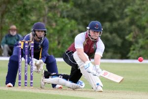 Banbury's Ed Phillips deals with another delivery as Tring Park wicket keeper Chloe Hill looks on at White Post Road. Photo: Steve Prouse