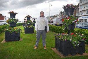 Andrew Crotty with the new plant pots in Bexhill