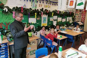 Father Jeremias George talking to pupils at Arundel CE Primary School about the work of FEAST (For Education and Social Transformation)