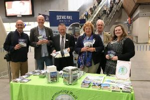 Some of the Sussex Rail Community Partnership's directors and volunteers on a promotional stand at London Bridge station.