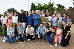 Tommy Cullen, centre, pictured with family and friends at his 75th birthday celebrations. DER3319-102KM