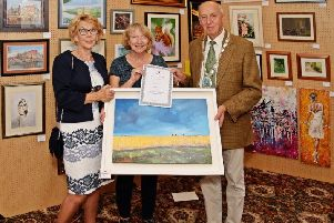 Pat Rowe with her oil painting 'Lincolnshire Idyll', which was awarded the SAA prize in 2018, being congratulated by the then Caistor Mayor and Mayoress, Alan and Gill Somerscales EMN-190813-103637001